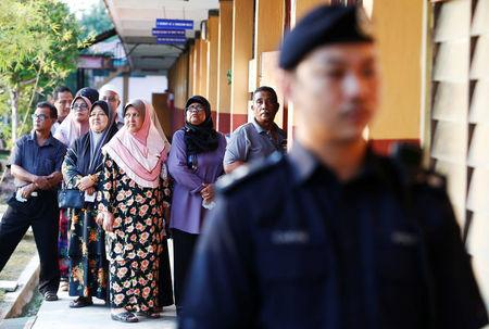People line up to vote during the general election in Alor Setar
