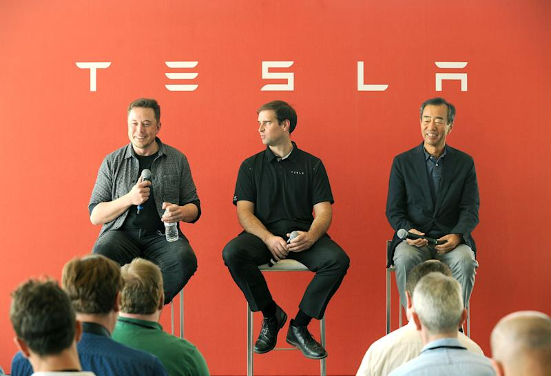 L-R: Tesla Chief Executive Elon Musk, Tesla Chief Technical Officer JB Straubel and Yoshi Yamada senior advisor from Panasonic participate in a news conference at the Tesla Gigafactory near Sparks, Nevada, U.S. on July 26, 2016. REUTERS/James Glover II