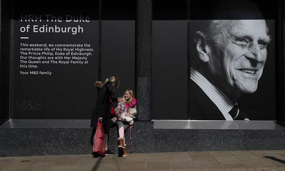 A portrait of Prince Philip in the window of a department store in Windsor, England.