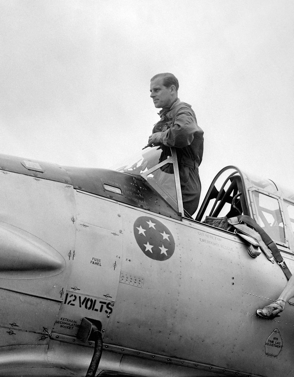 Prince Philip, the Duke of Edinburgh in the cockpit of a plane at White Waltham airfield in Berkshire today, when he made his last three flights before qualifying for his Royal Air Force wings.