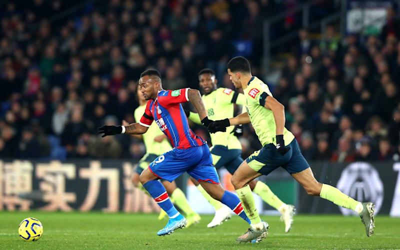 Jordan Ayew of Crystal Palace and Dominic Solanke of AFC Bournemouth challenges se the ball during the Premier League match between Crystal Palace and AFC Bournemouth - Getty Images