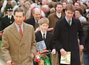 Princes William (far right) and Harry, clutch gifts from wellwishers as they leave Sandringham Church with their father, Prince Charles, after attending morning service in 1997. (John Stillwell/PA)
