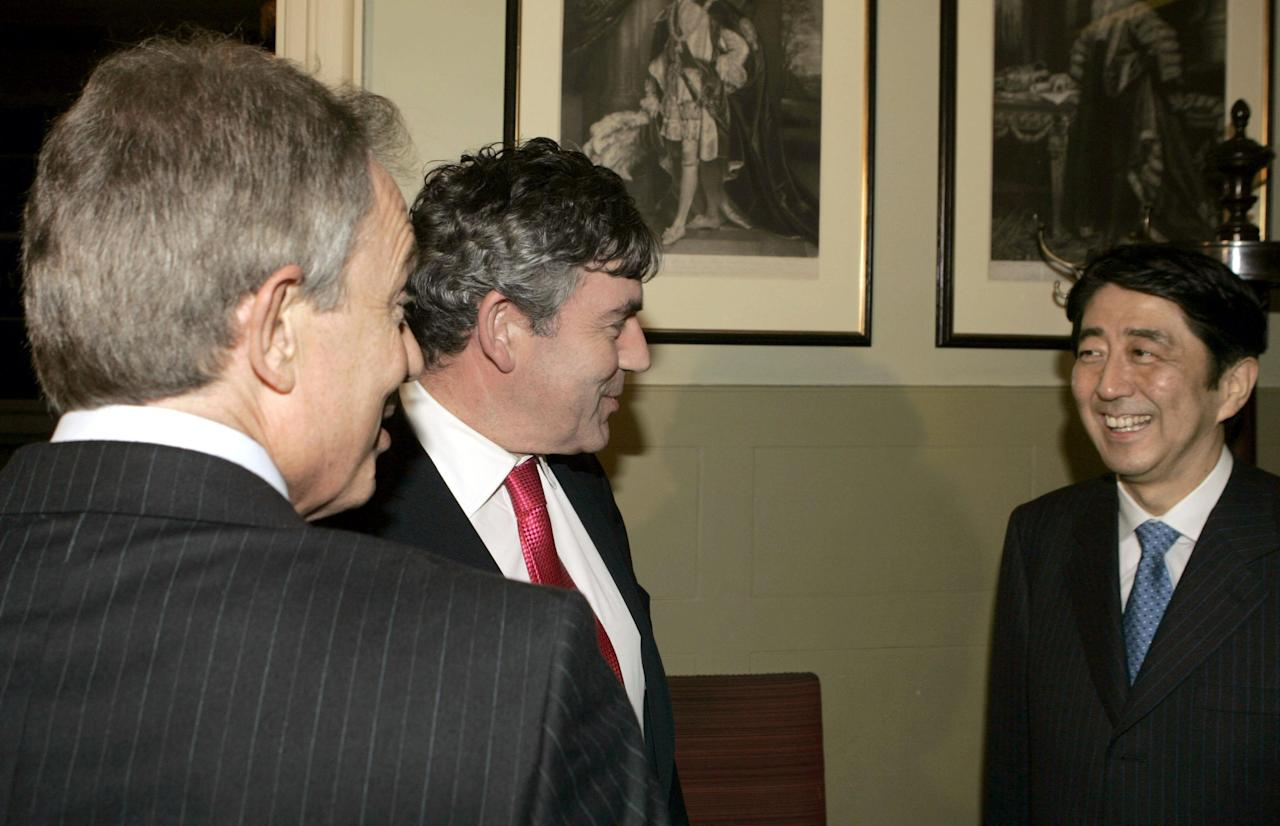 Britain's Prime Minister Tony Blair (left) Chancellor of the Exchequer Gordon Brown (centre) and Japan's Prime Minister Shinzo Abe meet at Downing Street in London.