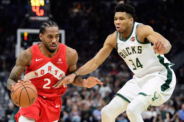 Raptors forward Kawhi Leonard drives against Bucks forward Giannis Antetokounmpo during the second half of Game 5. (AP)