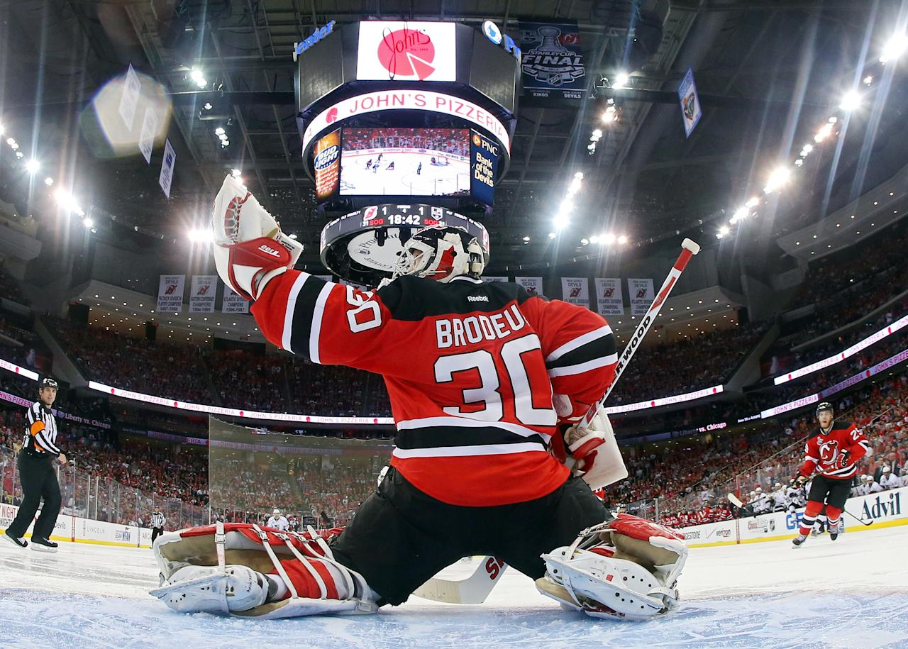 NEWARK, NJ - JUNE 02: Martin Brodeur #30 of the New Jersey Devils makes a glove save against the Los Angeles Kings during Game Two of the 2012 NHL Stanley Cup Final at the Prudential Center on June 2, 2012 in Newark, New Jersey.  (Photo by Bruce Bennett/Getty Images)