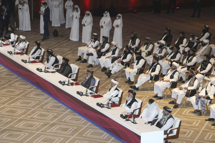 Taliban negotiator Abbas Stanikzai, fifth right, with his delegation attend the opening session of the peace talks between the Afghan government and the Taliban in Doha, Qatar, Saturday, Sept. 12, 2020. (AP Photo/Hussein Sayed)