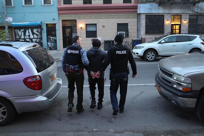 In this 2018 file photo, U.S. Immigration and Customs Enforcement officers arrest an undocumented Mexican immigrant during a raid in the Bushwick neighborhood of Brooklyn, New York.