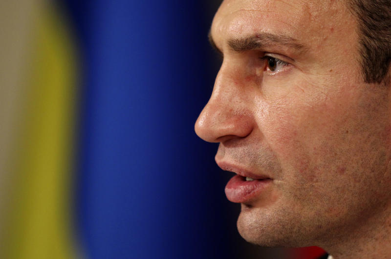Chairman of the Ukrainian opposition party Udar (Punch) and WBC Heavyweight Champion boxer Vitali Klitschko speaks to the media during his news conference in Kiev, Ukraine, Monday, Oct. 29, 2012. Klitschko's party garnered 13 percent  of the vote during Sunday's parliamentary elections in Ukraine. (AP Photo/Alexander Kosarev)