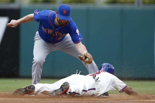 Philadelphia Phillies' Ben Revere, right, steals second under the tag from New York Mets second baseman Daniel Murphy during the third inning of a baseball game, Monday, Aug. 11, 2014, in Philadelphia. (AP Photo/Matt Slocum)