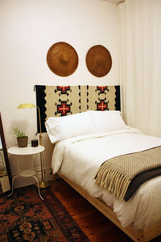 """<div class=""""caption-credit""""> Photo by: Carolyn Purnell via ApartmentTherapy.com</div><b>A Rug Headboard</b> <br> Standard college dorm beds rarely come with a headboard, so make a your own by hanging a vintage woven rug. We love the Southwestern feel of this one, but of course you're free to choose your own style! <br> <b><i><a rel=""""nofollow noopener"""" href=""""http://blogs.babble.com/the-new-home-ec/2011/08/18/20-diy-headboard-ideas-to-make/"""" target=""""_blank"""" data-ylk=""""slk:Related: 20 unique DIY headboards you won't find at Pottery Barn"""" class=""""link rapid-noclick-resp"""">Related: 20 unique DIY headboards you won't find at Pottery Barn</a></i></b><b><i><br></i></b>"""