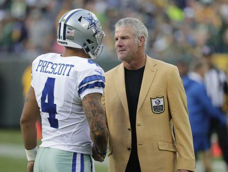 Oct 16, 2016; Green Bay, WI, USA; Dallas Cowboys quarterback Dak Prescott (4) greets Former Green Day Packers quarterback Brett Favre (R) after being introduced to the Hall of Fame at Lambeau Field. Mandatory Credit: Jim Matthews/Wisconsin via USA TODAY Sports