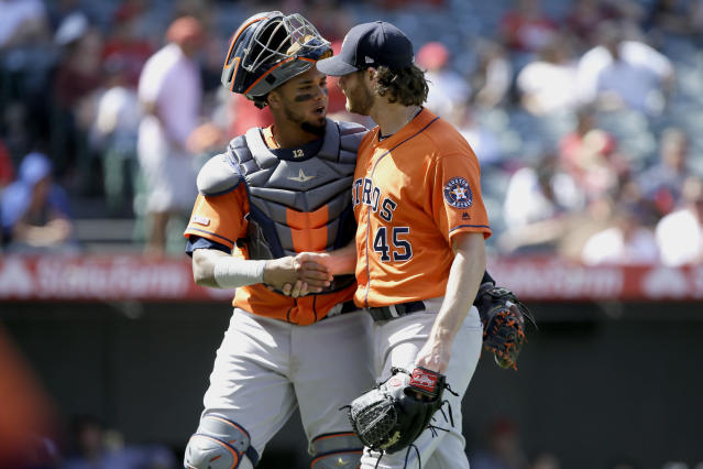 Houston Astros catcher Martin Maldonado, left, congratulates starting pitcher Gerrit Cole after the fifth inning of a baseball game against the Los Angeles Angels in Anaheim, Calif., Sunday, Sept. 29, 2019. (AP Photo/Alex Gallardo)