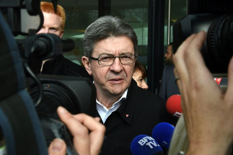 French presidential election candidate for the far-left coalition La France insoumise Jean-Luc Melenchon visits the library of the Lille 1 University in Villeneuve-d'Ascq, northern France, on April 11, 2017, as part of a campaign visit