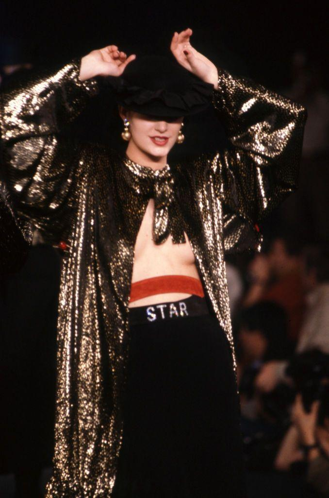<p>A model poses on the runway in a gold sequined top and trousers at the Sonia Rykiel spring 1983 fashion show. </p>