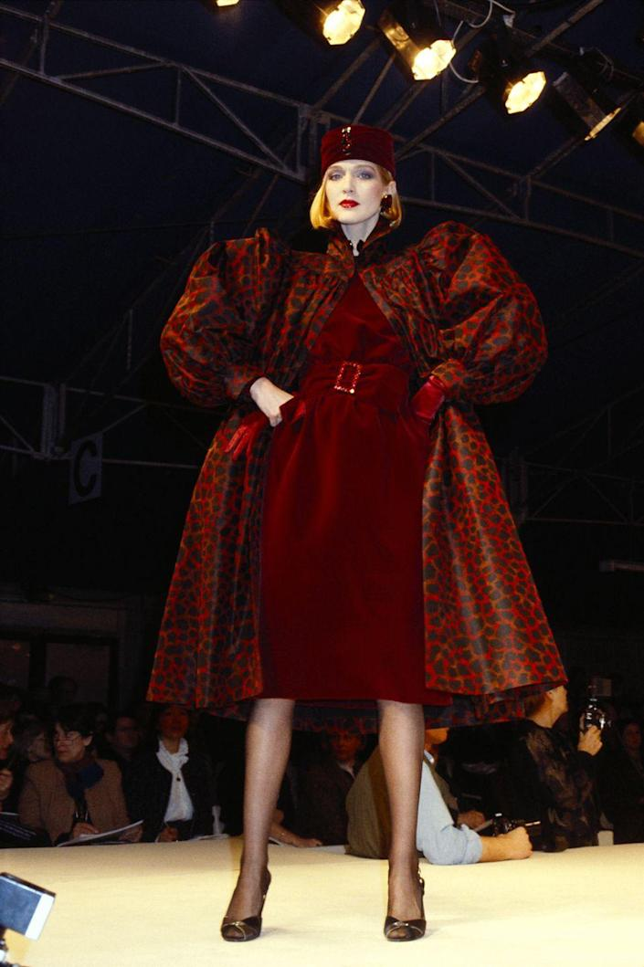 <p>A model wears a puff-sleeved red leopard-print coat at Givenchy's fall 1984 runway show during Paris Fashion Week. </p>
