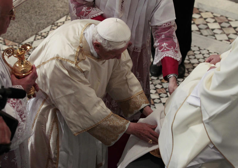 Pope Benedict XVI. center, washes the foot of an unidentified layman, during the Holy Thursday rite of the washing of the feet, in St. John in Lateran Basilica in Rome, Thursday, April 5, 2012. (AP Photo/Gregorio Borgia)