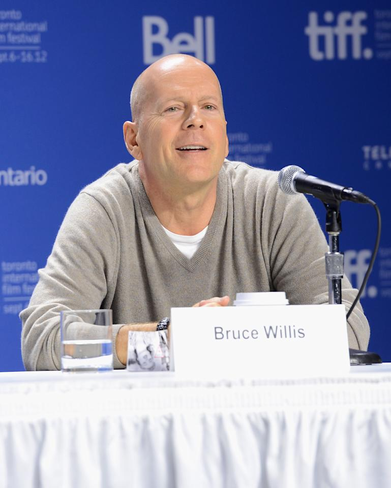 "TORONTO, ON - SEPTEMBER 06:  Actor Bruce Willis speaks onstage at the ""Looper"" press conference during the 2012 Toronto International Film Festival at TIFF Bell Lightbox on September 6, 2012 in Toronto, Canada.  (Photo by Jason Merritt/Getty Images)"