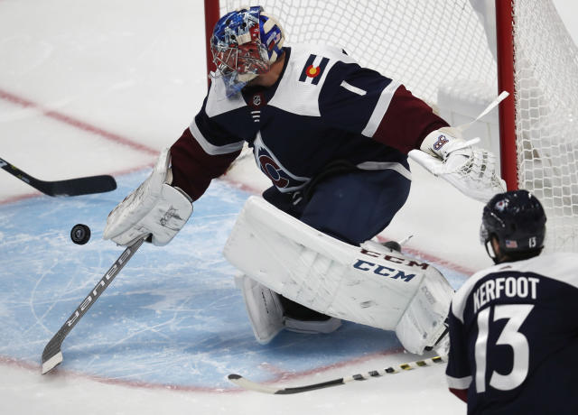 Colorado Avalanche goaltender Semyon Varlamov makes a stick save of a shot against the Nashville Predators in the first period of an NHL hockey game Wednesday, Nov. 7, 2018, in Denver. (AP Photo/David Zalubowski)