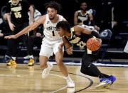Purdue's Jaden Ivey dribbles around Penn State's Seth Lundy during an NCAA college basketball game Friday, Feb. 26, 2021, in State College, Pa. (Abby Drey/Centre Daily Times via AP)