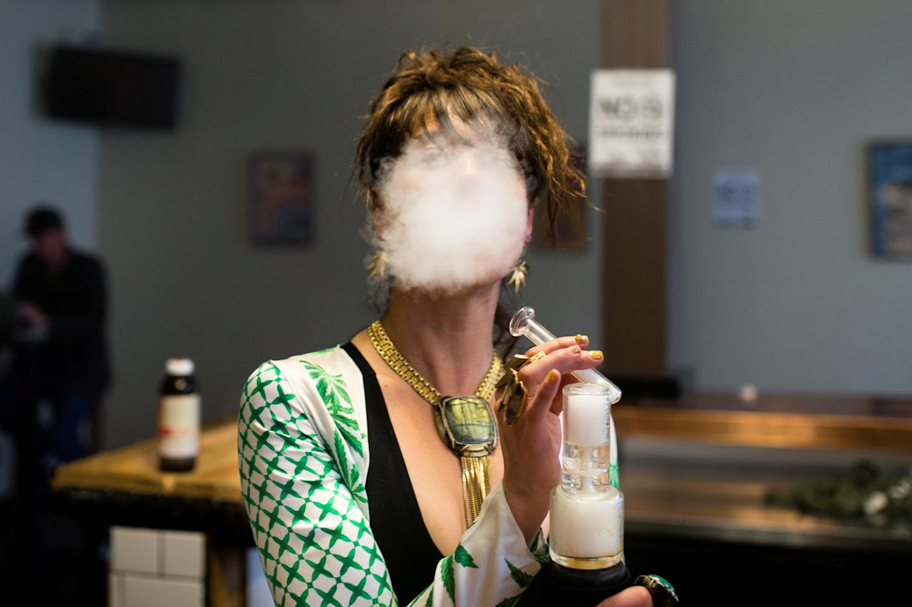 Elise McRoberts exhales after using a full spectrum oil vaporizer at the new Magnolia cannabis vape lounge in Oakland, California, U.S. April 20, 2018. Friday marked the first '4/20' since the sale of recreational marijuana became legal on January 1. REUTERS/Elijah Nouvelage     TPX IMAGES OF THE DAY
