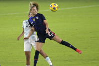United States midfielder Kristie Mewis (22) and Argentina midfielder Daiana Falfan (20) compete for a header during the first half of a SheBelieves Cup women's soccer match, Wednesday, Feb. 24, 2021, in Orlando, Fla. (AP Photo/Phelan M. Ebenhack)