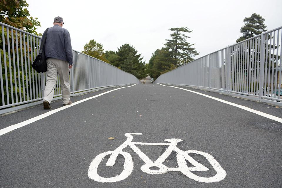 Problem: The giant cycle lane has made the pedestrian walkway 'too narrow' (SWNS)