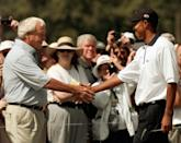 <p>Four-time Masters Champion Arnold Palmer, left, greets defending Masters champion Tiger Woods, right, before teeing off for their practice rounds at for the 1998 Masters at the Augusta National Golf Club in Augusta, Ga., Tuesday, April 7, 1988. (AP Photo/Amy Sancetta) </p>