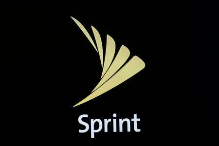 The Sprint logo is displayed on a a screen on the floor of the New York Stock Exchange (NYSE) in New York City, U.S., April 30, 2018. REUTERS/Brendan McDermid