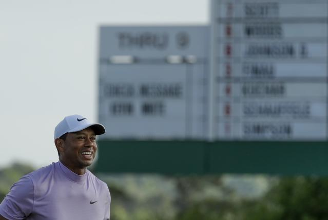 Tiger Woods smiles as he walks off the 18th green during the third round for the Masters golf tournament Saturday, April 13, 2019, in Augusta, Ga. (AP Photo/Chris Carlson)