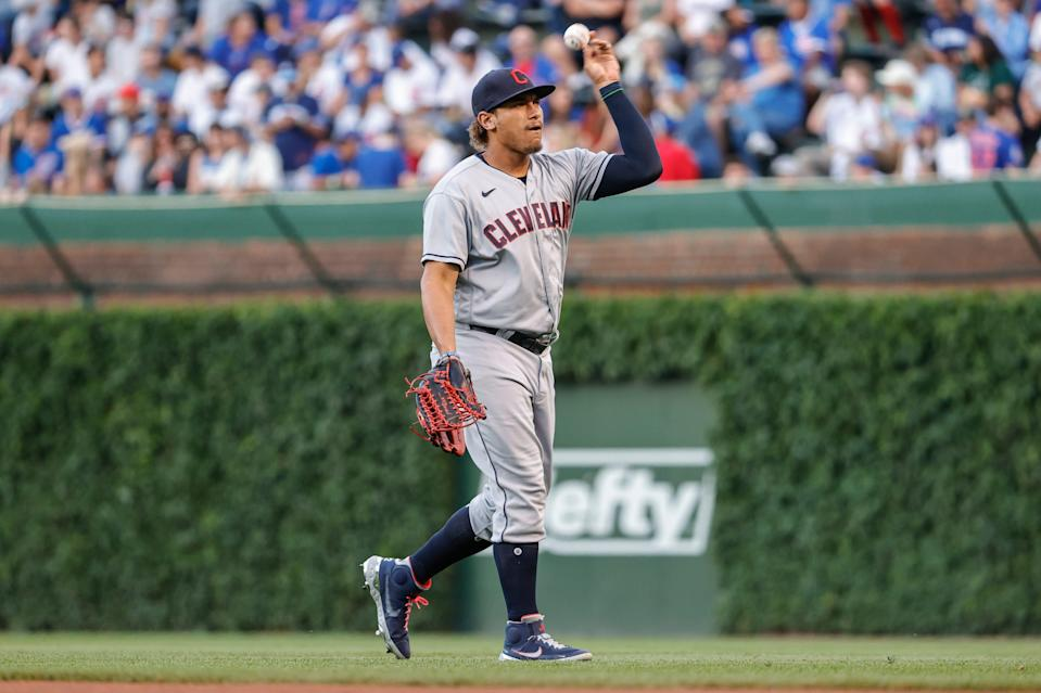 Cleveland left fielder Josh Naylor (22) warms up before a baseball game against the Chicago Cubs at Wrigley Field.
