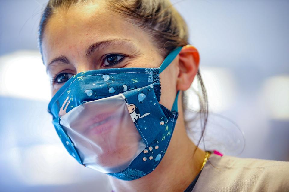 Clear masks have been touted as a means of facilitating communication for the hearing impaired. But many in the deaf community have other ideas about how to be most inclusive. (Photo: BRUNO FAHY/Belga/AFP via Getty Images)