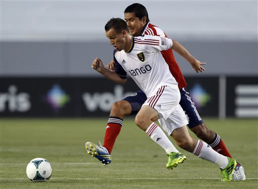 Real Salt Lake midfielder Luis Gil (21) battles Chivas USA defender Walter Vilchez (4) for the ball during the first half of an MLS soccer game in Carson, Calif., Sunday, May 19, 2013. (AP Photo/Alex Gallardo)