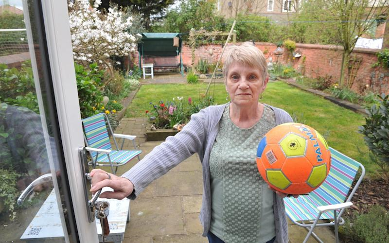 Penny Freeman from Bridlington, Yorkshire, is fed up of her plants getting damaged by footballs - Hull Daily Mail / SWNS.com