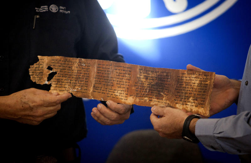 A copy of a part of the Dead Sea Scrolls is presented during a joint Israel Antiquities Authority, IAA, and Google press conference in Jerusalem, Tuesday, Dec. 18, 2012. Israeli authorities say they have put 5,000 fragments of the ancient Dead Sea scrolls online in a partnership with Google.(AP Photo/Dan Balilty)
