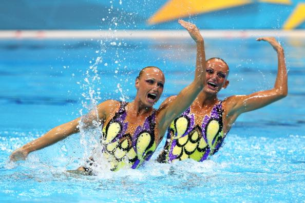 LONDON, ENGLAND - AUGUST 05:  Nadine Brandl and Livia Lang of Austria compete in the Women's Duets Synchronised Swimming Technical Routine on Day 9 of the London 2012 Olympic Games at the Aquatics Centre  on August 5, 2012 in London, England.  (Photo by Clive Rose/Getty Images)