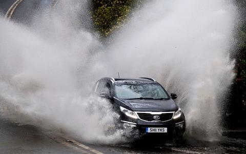 car floodwater spray - Credit: Owen Humphreys/PA