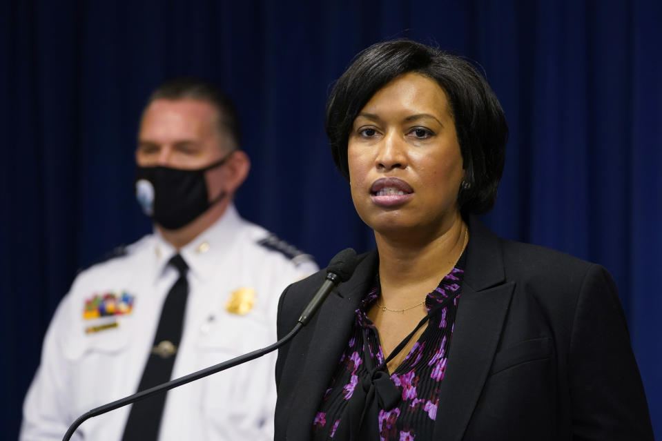 District of Columbia Mayor Muriel Bowser, right, standing next to Metropolitan Police Department chief Peter Newsham, left, speaks during a news conference in Washington, Wednesday, Nov. 4, 2020. (AP Photo/Susan Walsh)