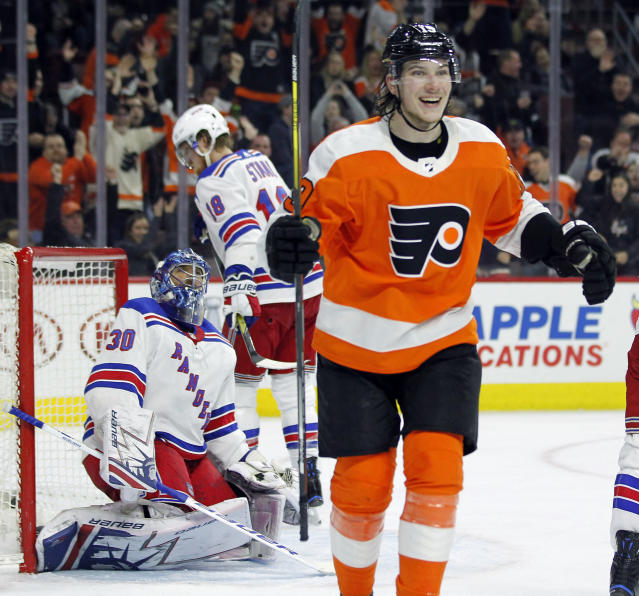 Philadelphia Flyers' Nolan Patrick, right, smiles as he skate over to congratulate Claude Giroux, not pictured, on his goal during the second period of an NHL hockey game against the New York Rangers, Saturday, April 7, 2018 in Philadelphia, PA. (AP Photo/Tom Mihalek)