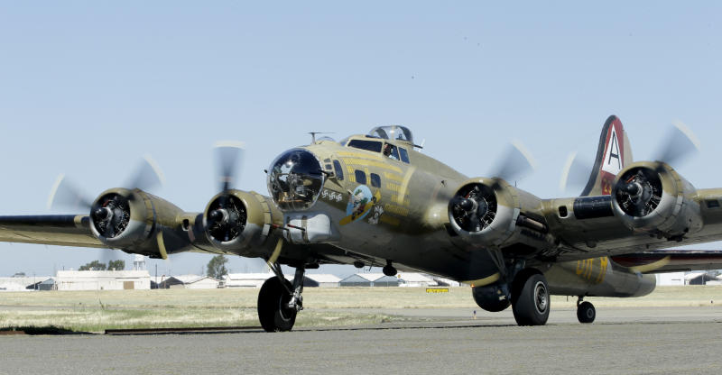 """In this photo taken June 2, 2018 photo, the Nine-O-Nine, a Collings Foundation B-17 Flying Fortress taxis after landing at McClellan Airport in Sacramento, Calif. A B-17 vintage World War II-era bomber plane crashed Wednesday, Oct. 2, 2019, just outside New England's second-busiest airport, and a fire-and-rescue operation was underway, official said. Airport officials said the plane was associated with the Collings Foundation, an educational group that brought its """"Wings of Freedom"""" vintage aircraft display to Bradley International Airport this week in Windsor Locks, Conn. (AP Photo/Rich Pedroncelli)"""