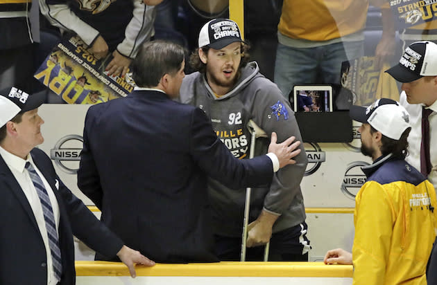 "Injured <a class=""link rapid-noclick-resp"" href=""/nhl/teams/nas/"" data-ylk=""slk:Nashville Predators"">Nashville Predators</a> center <a class=""link rapid-noclick-resp"" href=""/nhl/players/4964/"" data-ylk=""slk:Ryan Johansen"">Ryan Johansen</a>, center, celebrates with Predators head coach Peter Laviolette after the Predators beat the <a class=""link rapid-noclick-resp"" href=""/nhl/teams/ana/"" data-ylk=""slk:Anaheim Ducks"">Anaheim Ducks</a> in Game 6 of the Western Conference final in the NHL hockey Stanley Cup playoffs Monday, May 22, 2017, in Nashville, Tenn. The Predators won 6-3 to win the series 4-2 and advance to the Stanley Cup Finals. (AP Photo/Mark Humphrey)"