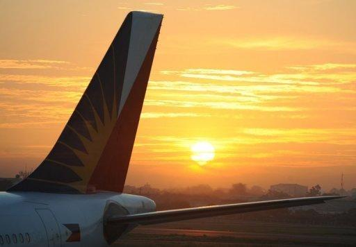 Philippine airlines planes are seen on the tarmac of the international airport in Manila in February 2012. San Miguel said Wednesday it had bought a 49-percent stake in loss-making Philippine Airlines for $500 million as part of a strategy to move away from its beer and food businesses