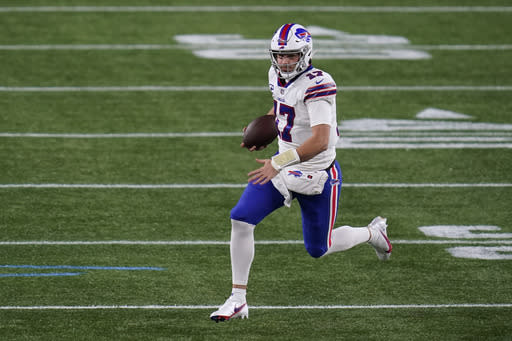 Buffalo Bills quarterback Josh Allen runs with the ball in the first half of an NFL football game against the New England Patriots, Monday, Dec. 28, 2020, in Foxborough, Mass. (AP Photo/Charles Krupa)
