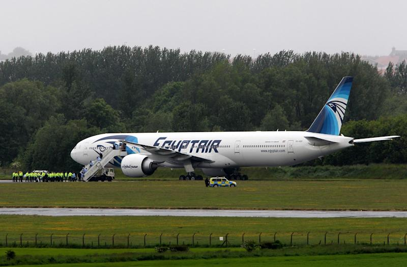 Passengers leave the Egyptair aircraft at Prestwick Airport, Scotland, after it was diverted while en route from Cairo to New York, Saturday June 15, 2013. It is reported that BBC employee Nada Tafik, who was on board the plane, said she found a note in a toilet apparently threatening to start a fire. The plane was escorted to Prestwick by Typhoon fighters from RAF Leuchars, near St. Andrews on the east coast of Scotland. (AP Photo/ Andrew Milligan /PA UNITED KINGDOM OUT