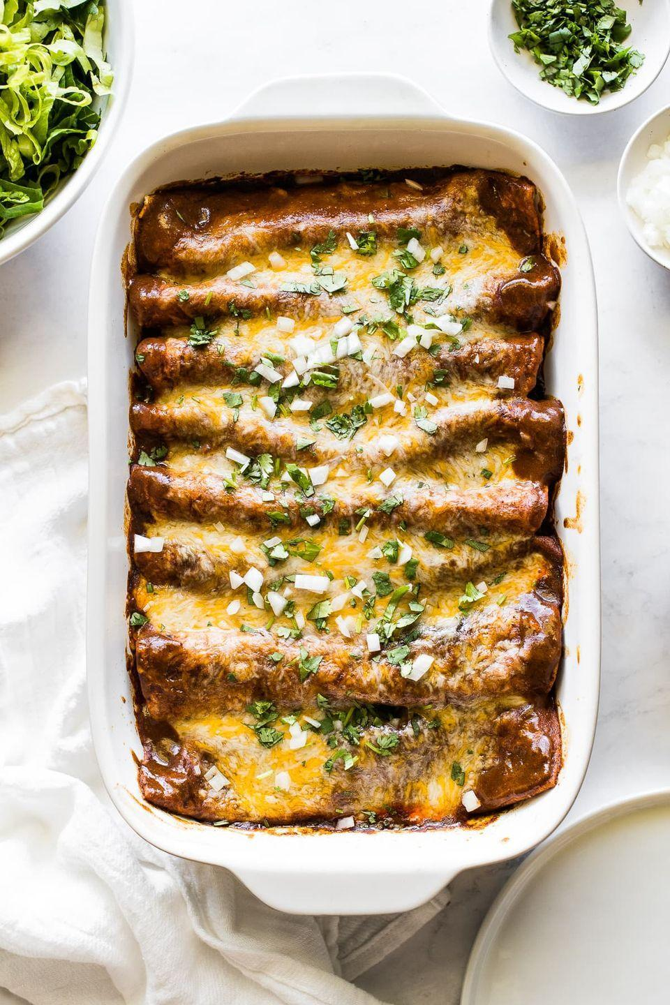 "<p>Stuffed with a ground beef, onion and garlic filling, then smothered in homemade sauce, these enchiladas make the best weeknight dinner (with tasty leftovers!).</p><p><em><a href=""https://www.isabeleats.com/beef-enchiladas/"" rel=""nofollow noopener"" target=""_blank"" data-ylk=""slk:Get the recipe from Isabel Eats »"" class=""link rapid-noclick-resp"">Get the recipe from Isabel Eats »</a></em></p>"