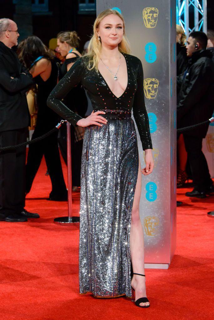 <p>Turner wore a black and silver sequin gown by Louis Vuitton at the awards in London.</p>