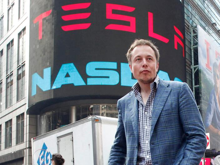 Elon Musk stands in front of the Nasdaq sign in Manhattan, New York, June 29, 2010.