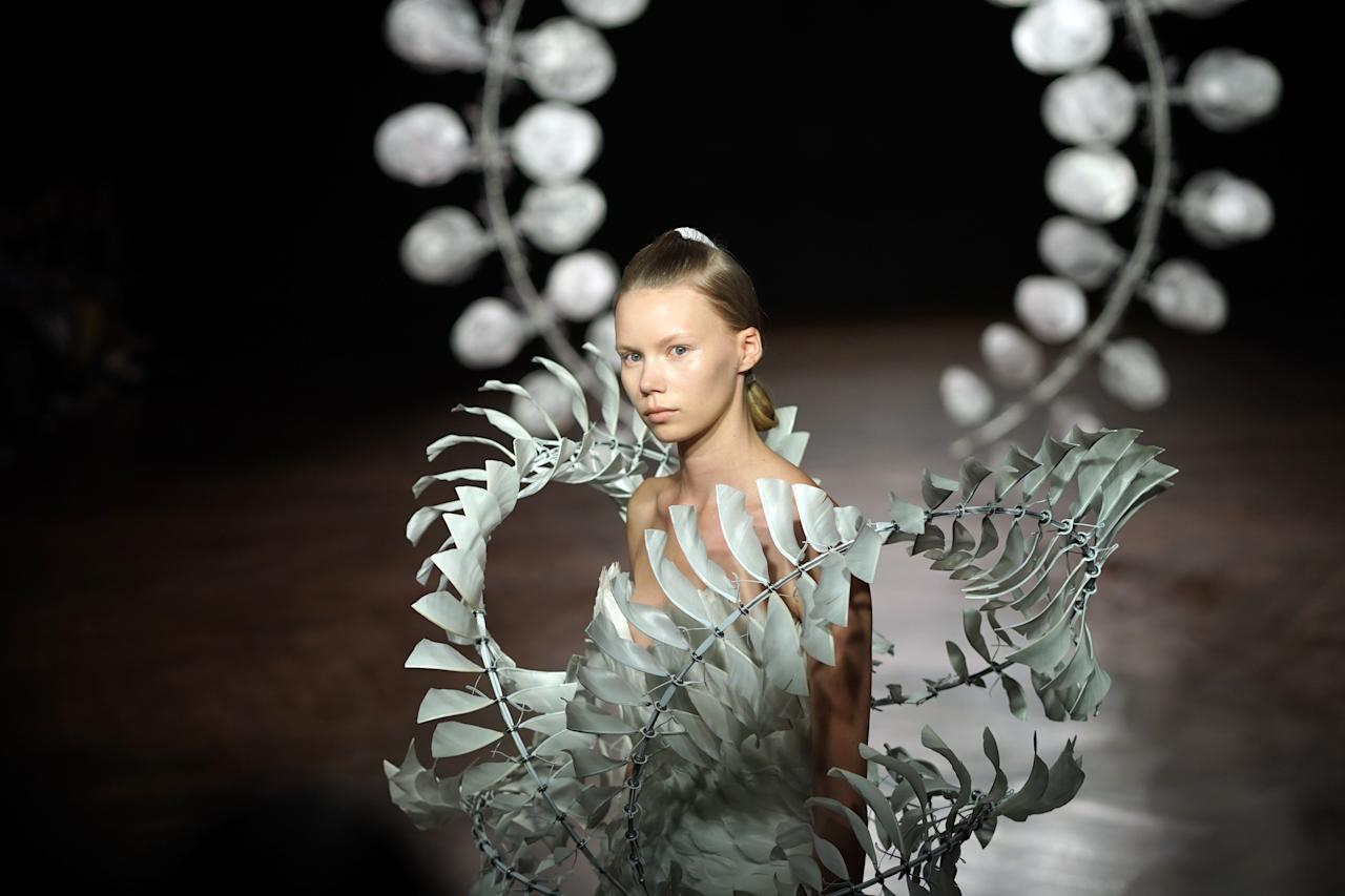 """<p>Paris Couture Week is where designers (and <a href=""""https://www.elle.com/fashion/celebrity-style/a26047182/celine-dion-paris-fashion-week/"""" target=""""_blank"""">Celine Dion</a>) get wild. Iris Van Herpen brought her signature futurism to a stunned crowd, Giambattista Valli's gargantuan evening wear is bound to be seen on a red carpet, and Christian Dior brought down the house. Literally.<em> There was a model wearing a house down the runway.</em> Click through for ELLE.com's favorite looks from the most whimsical time in the fashion calendar and check back as we'll be updating our gallery with even more crazy runway looks as the season continues.</p>"""