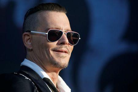 Actor Johnny Depp performs with the Hollywood Vampires band during the Hellfest music Festival in Clisson
