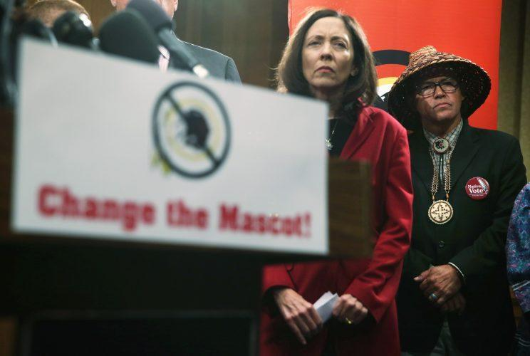 U.S. Sen. Maria Cantwell (D-WA) (L) and National Congress of American Indians (NCAI) President Brian Cladoosby stand by, listening, at a news conference in Washington, DC on September 14, 2016. The two leaders participated in a news conference held by Change the Mascot to push for the renaming of the Washington football team. (Alex Wong/Getty Images)