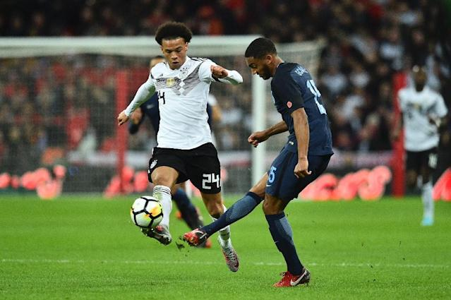England's Joseph Gomez (R) vies with Germany's Leroy Sane (L) during their match at Wembley Stadium in London on November 10, 2017 (AFP Photo/Glyn KIRK )